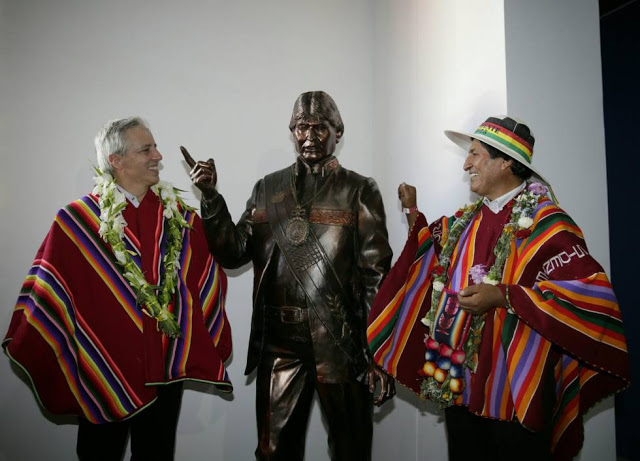 Evo Morales and his statue next to Linera